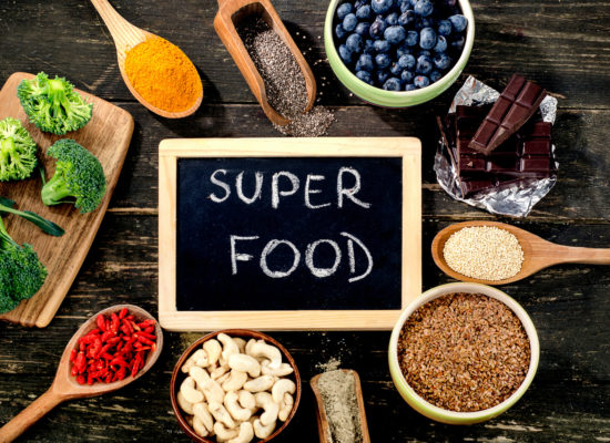 Super foods on rustic wooden background. Top view